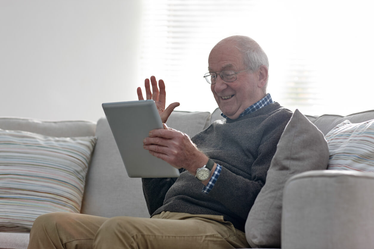 older gentleman using technology for video call