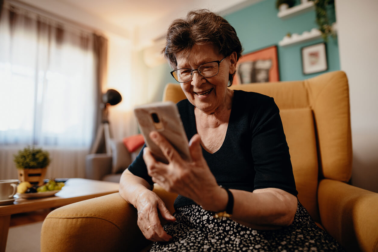 mature woman using phone for telehealth